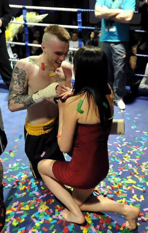 Ricky Welsby pictured with girldfriend Nikki Vyse after proposing to her at a charity boxing event at the Copthorne Hotel in Brierley Hill, West Midlands.  See NTI story NTIRING.  A pair of boxers proved they were both lovers and fighters by serving a knockout marriage proposal minutes after a gruelling FIGHT.  Romantic Adrian Firkins, 44, and Ricky Welsby, 24, went toe to toe for three rounds before judges ruled the contest as a draw on Friday (14/3) night.  Fight promoter Pete Jackson, 38, then called Mr Firkinís girlfriend, Debbie Tyler, 41, and Mr Welsbyís other half Nikki Vyse, 22, to the ring to pose for some ëphotographsí.  But as the women got ready for the snaps, the two out-of-breath fighters were handed the diamond rings from Mr Jackson and immediately dropped to one knee side-by-side to present their girlfriends with them.